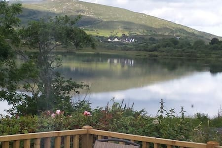 Charming 3 bedroom family home located on the shores of Lough Agrafford 3 miles west of Oughterard. Tastefully redecorated and recently extended. Convenient for fishing, walking, mountain biking, touring Connemara or just lazy days by the lake.