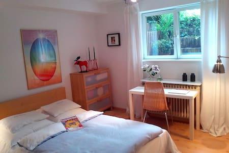 Bright basement room + garden