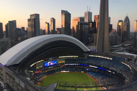 I rent my condo by the rogers centre. It's a one bed room on the 37th floor. straight view on the roger centers and the cn tower! enjoy the blue jays games for free :) 1 queen bed in the room and 1 couch in the living room. many amenities.