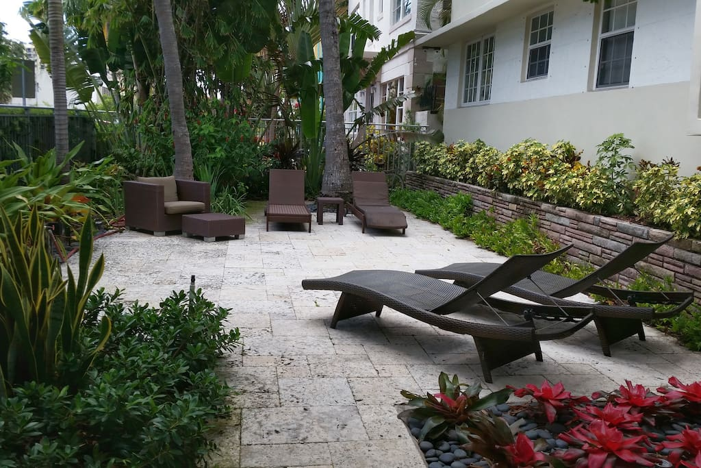 Guests have access to outdoor lounge chairs in the building's small cloistered courtyard. Perfect place for an at-home drinky.