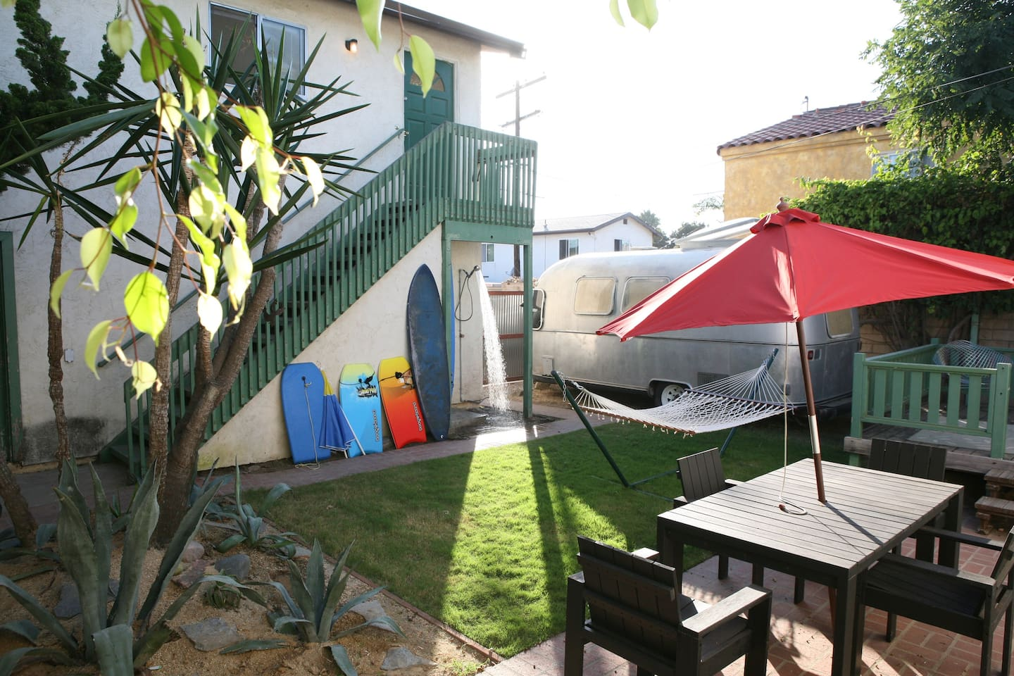 back yard with bbq, outdoor shower, airstream, shared beach toys&bikes- secured garage parking- unit is UPSTAIRS