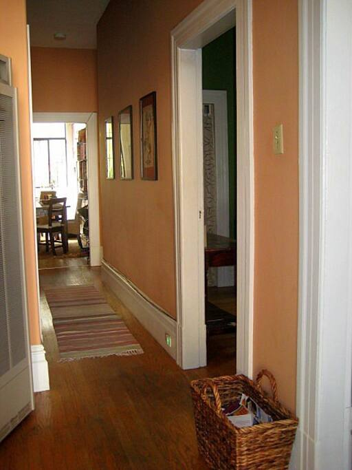Front entry looking down hall into kitchen.  Living room and your room are off to the right.