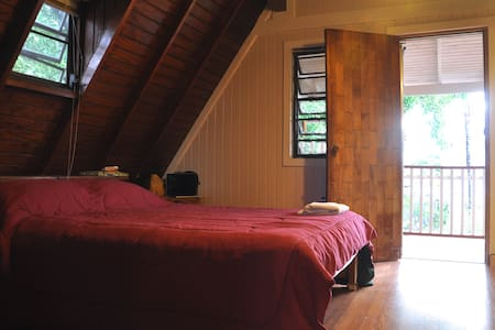 Private bedroom in breezy chalet
