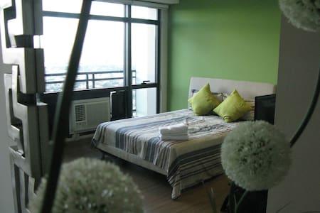 Gramercy Cozy Studio overlooking Infinity Pool - Makati