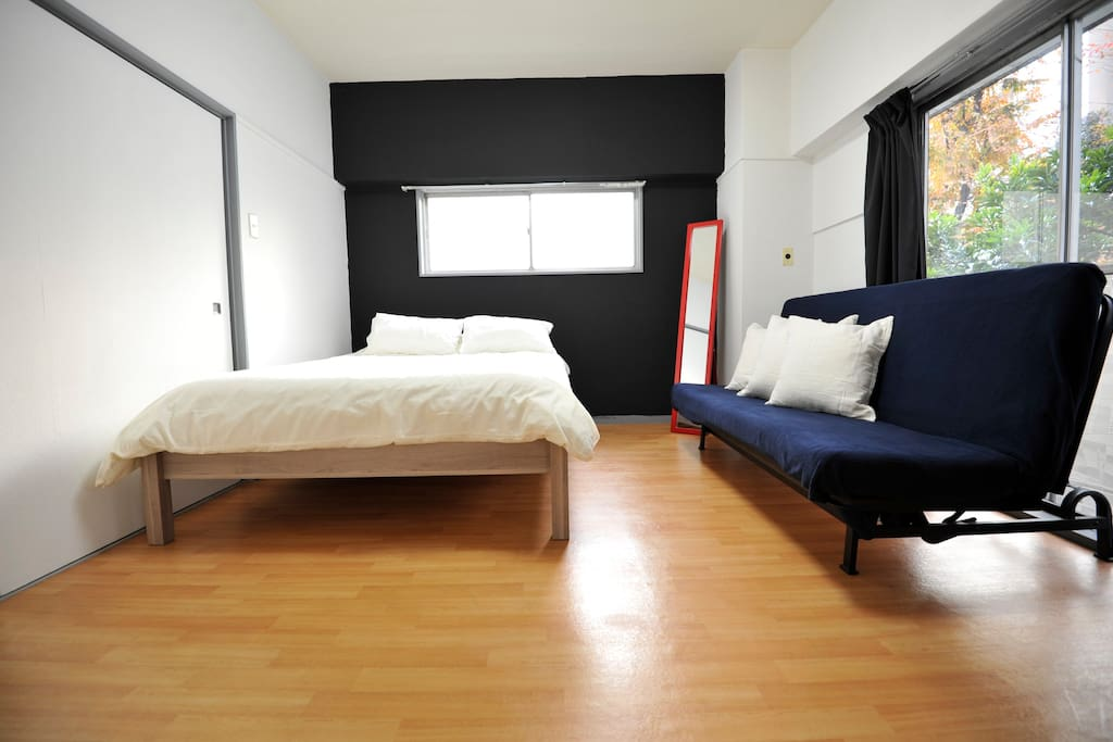 Large double sized bed plus sofa bed with linens and towels.