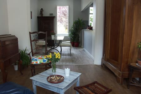 Newly restored peaceful house  near town centre, station , supermarket    small pleasant garden  , a  sheltered terrace , a living room , a dining room , an open kitchen , 1 bathroom and toilets, piano ,hammock Fluent English spoken