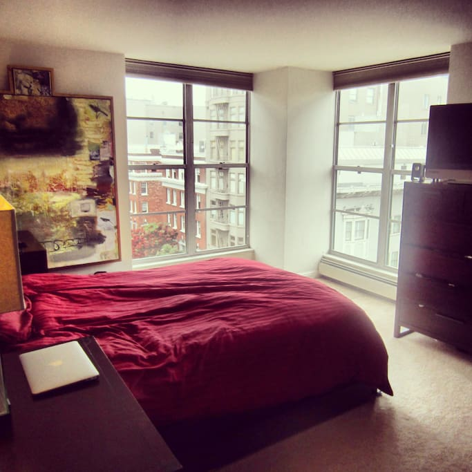 Your Master Bedroom with spacious closet, full-length mirror, luxury European mattress, plenty of natural light, sweeping views of San Francisco, and blackout window shades.