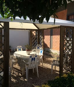 Confortable and nice appartment. Located in a small condo of two stores. Nice garden fully equipped with gazebo and barbeque. bedroom, living area with sofà bed ( sleeps two ), Other two single beds are located in the corridor.bathroom with shower, kitchen fully equipped for 6 people. Two terraces.