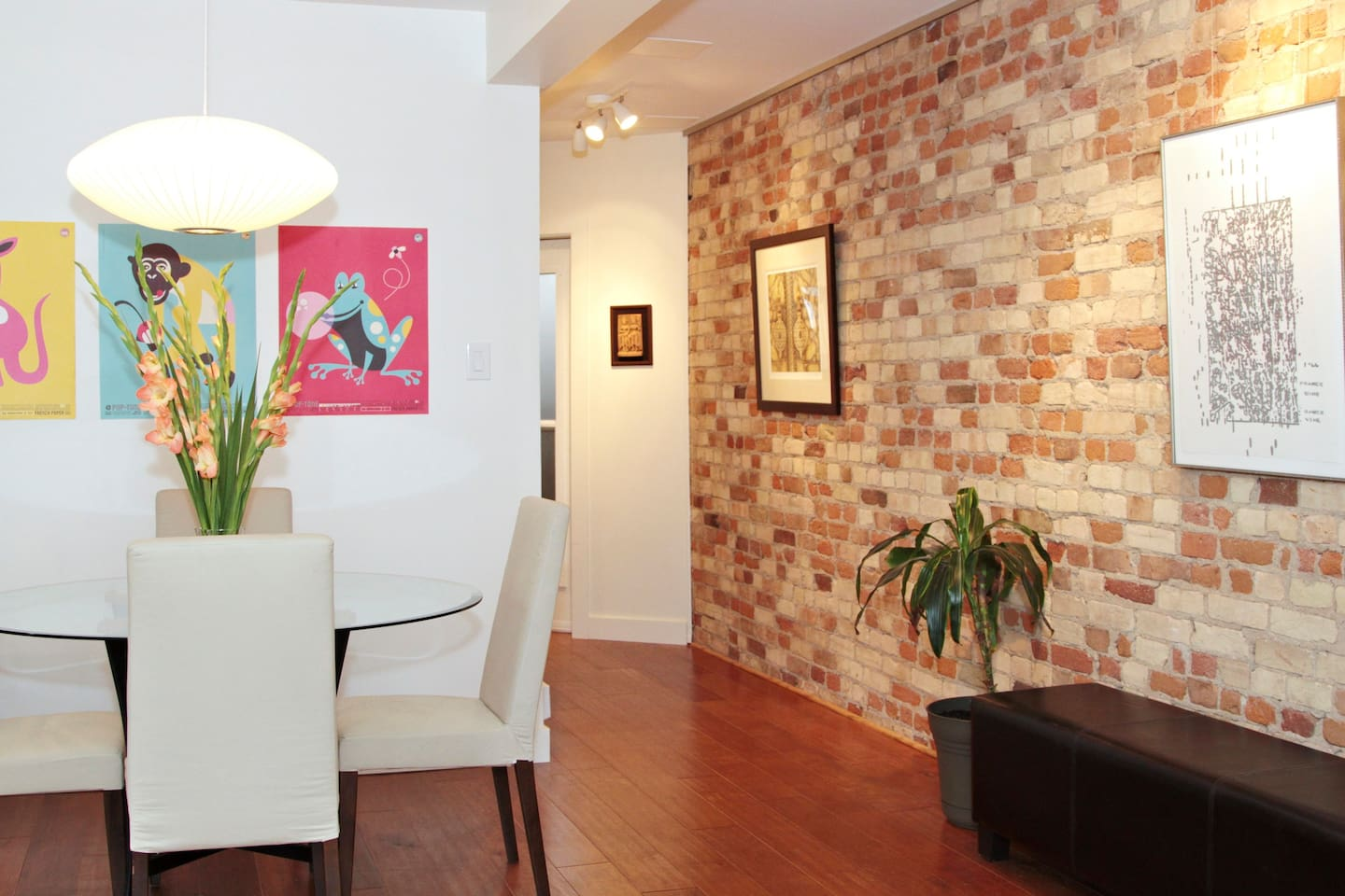 Dining room and brick wall of art