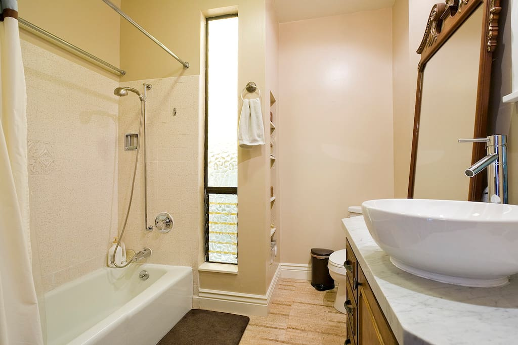 Clean, modern bathroom with excellent water pressure