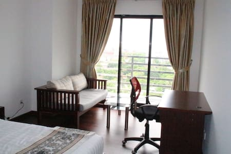 New condominium, on 11th floor overlooking the city, close to the railway station & Shwedagon with lots of local culture!! Large bedroom with balcony (twin beds can be joined), shared living room and separate bathroom. Host lives in.