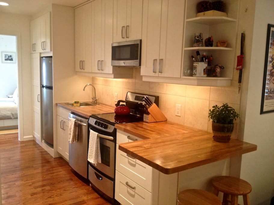 Our full sized kitchen has a full size fridge, oven, microwave & dishwasher.