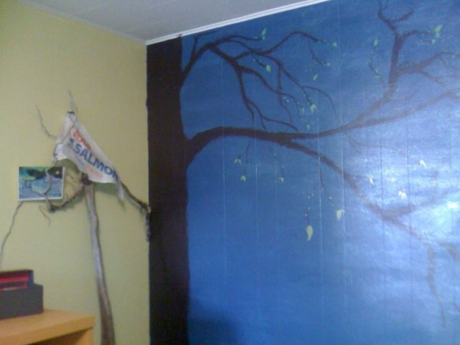 Walled painted to represent a tree and moon glow at night here in the Valley of the Moon