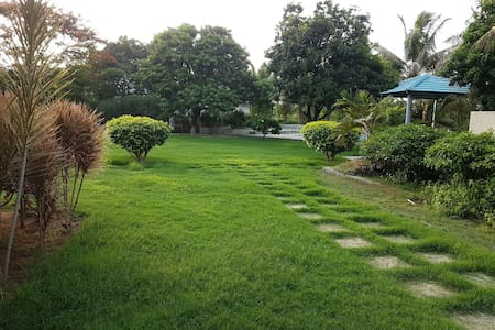Green farmhouse with swimming pool and green lawn. - Villa