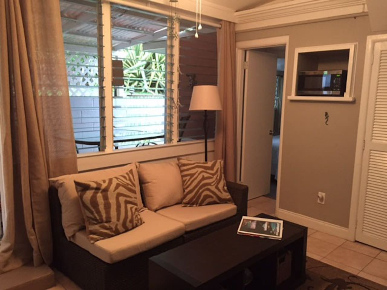 Living area with couch. Unit has a HD TV and DVD player.