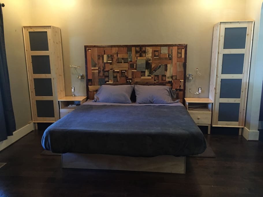 King size memory foam bed, with a nightstand & wardrobe on each side