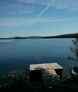 Located on Great Moose Pond, an exceptionally beautiful lake in Central Maine. This spacious cedar and pine cabin is the perfect spot for family reunions and fishing weekends.