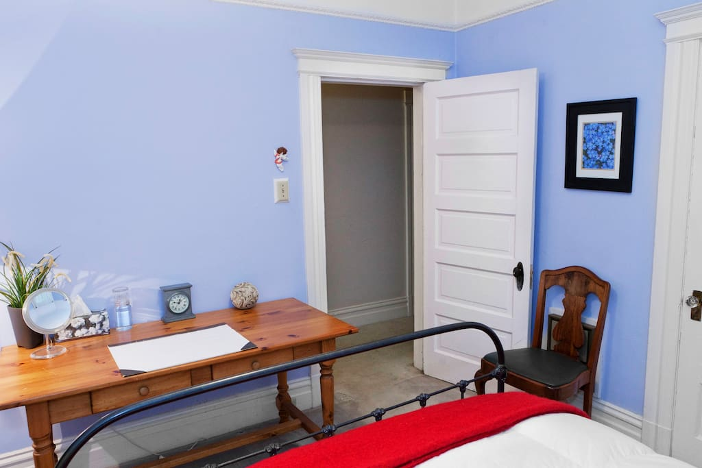 As you'll see, this is a well-lighted room with a desk and closet