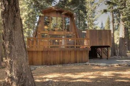 This mountain styled north Tahoe vacation rental home features three bedrooms/two baths and a loft and can accommodate up to 8 people. The rental home has been remodeled including the kitchen, bathrooms, decks, cedar siding, and hot tub.