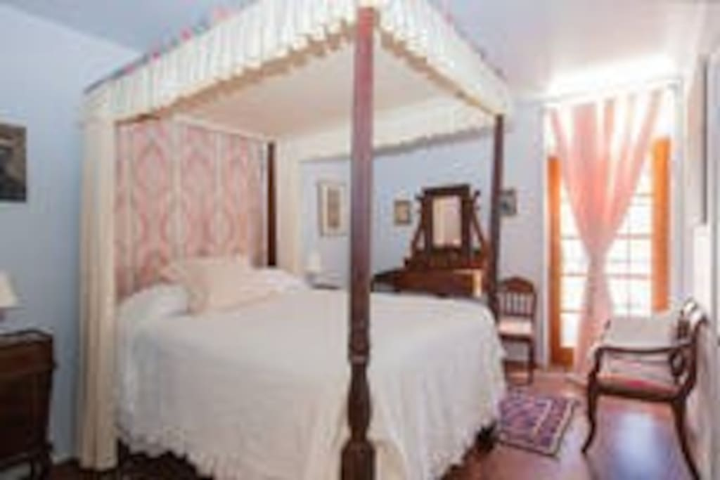 Your double room with canopy bed.
