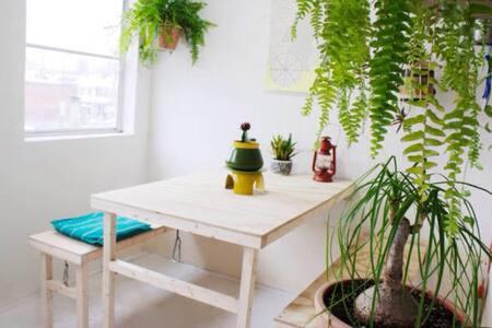 Room in bright sunny artist loft
