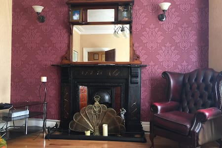 There are 8 bedrooms, each with its own bathroom.    A lovely Victorian home, five minutes walk to all Derry City amenities, including City Walls, museums, and night life.    The home features a nice living room,  dining space, and a kitchen.  Group rates available.