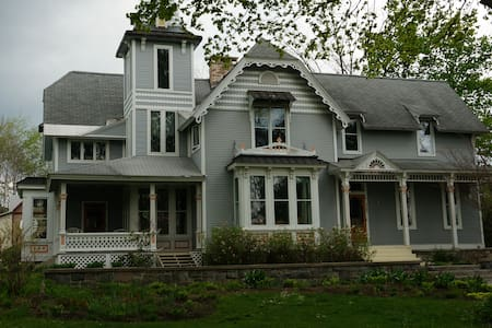 The house is situated in the heart of downtown Traverse City. A historic , Victorian home with a beautiful view of the bay. It's a walking distance to the beaches, park, restaurant, grocery, hospital and bike trail.
