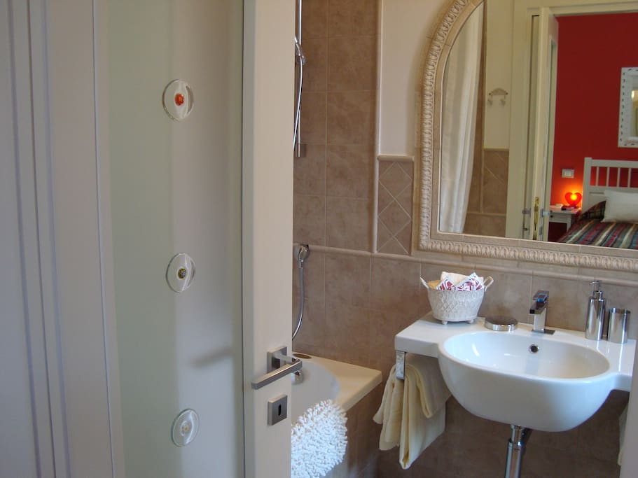 Pompeian Red Room ensuite bathroom with tub and shower