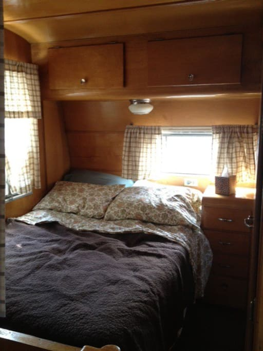 The bed from the kitchen.  Cozy sheets and extra blankets are provided.