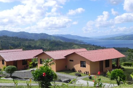 We have 3 Cabinas located on the level below the main house and pool. Each accommodate 4 persons with a queen size bed and a futon that opens to a double bed. They have private baths, kitchenettes and private patios with hammocks and rocking chairs.