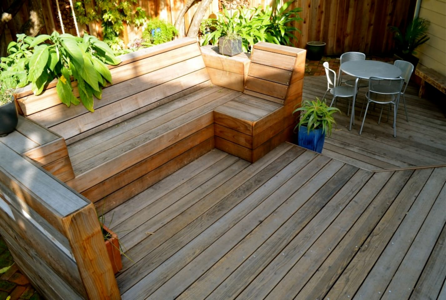 Custom designed redwood bench and (shared) deck is accessible from kitchen