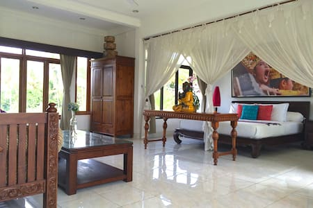 A luxuriously furnished loft style villa in the serene rice fields of Ubud. Panoramic views from both sides, and just a ten minute stroll through a quaint local village street off Ubud centre, lined with shops and cafes.  Sleeps up to 4 people.