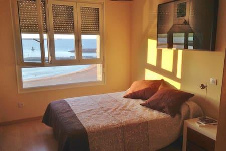 Habitación frente a la playa - Apartment