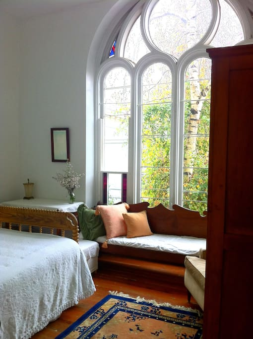The chapel room has a view of the garden.
