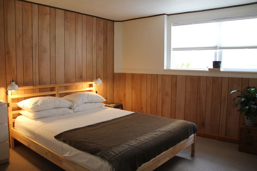 Separate bedroom sleeps two on a queen-sized bed, and...