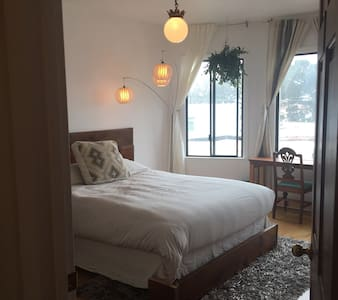 Bright private bedroom in home 1