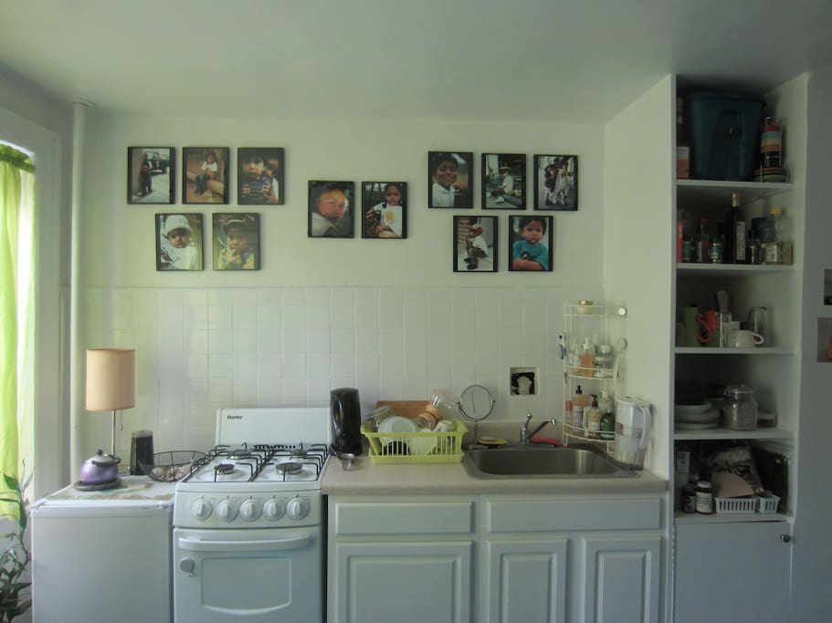 You are welcome to cook if you don't use too much oil (no ventilation system).  The fridge is tiny, but it does the job!
