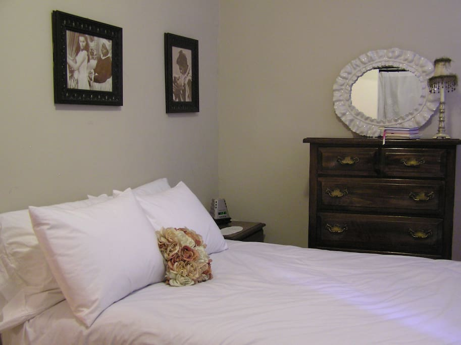 Bedroom with comfortable, full size bed.