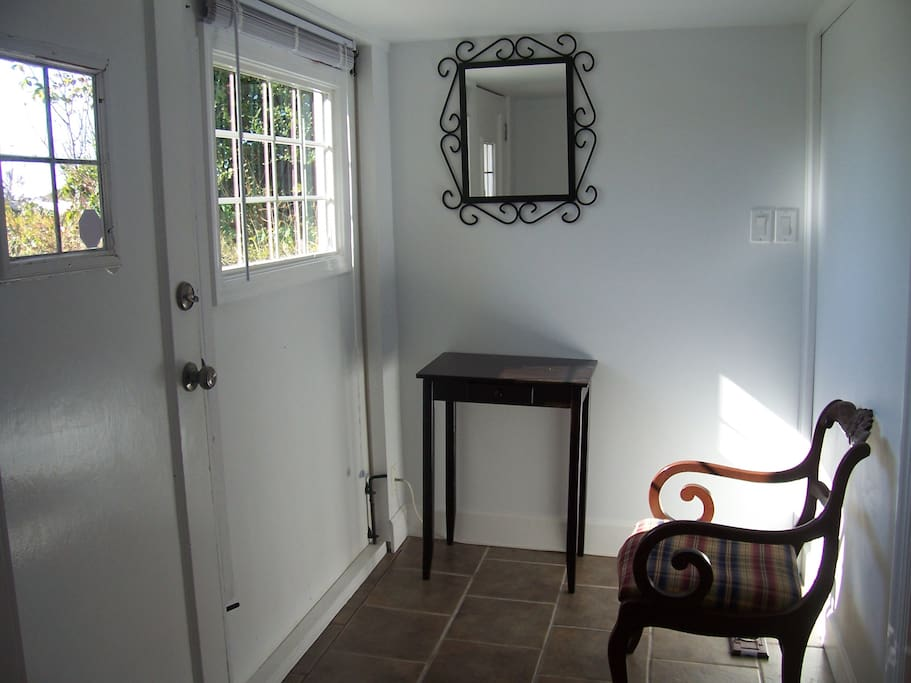 Front Entrance/ Foyer. Space to hang coats and store shoes.