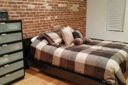 Private Room with exposed brick throughout apt., vibes a true city feeling! Comfortably fits 2 in a large air conditioned room. Centrally located accross from Ft. Tryon Park & The Cloisters Museum, which overlooks the Hudson River & near 1 & A trains