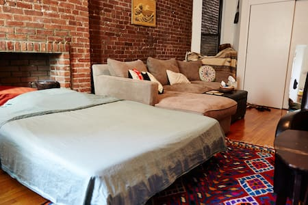 I have a 1 bedroom apt with a very spacious living room for guests, including a full bed w/memory foam mattress. I provide linens, towels and bathroom/kitchen/closet storage space. Kitchen is small, but all the amenities are available. NO SHOES :)