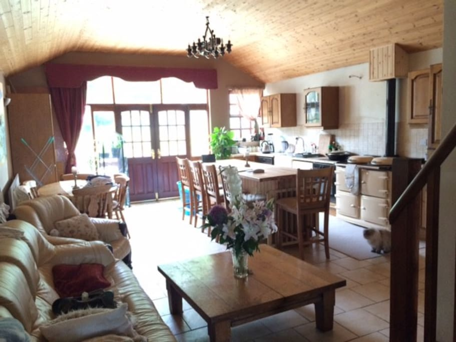 Kitchen with 8-foot island, breakfast bar and 5 high stools, oil-fired range cooker and oak kitchen.