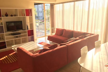 Modern,  bright, uplifting space in sought after Harbour View complex.  On the Marina promenade and on top of all conveniences,  included Dart to town just across the street.   Floor to ceiling windows throughout,  3 bedrooms with access to balcony. En suite master bedroom.   Designated car park space.   WiFi  All appliances on site.   Caretaker on site. CHECK IN   :  usually at 3 pm   CHECK OUT : usually by 11 am  Otherwise flexible.