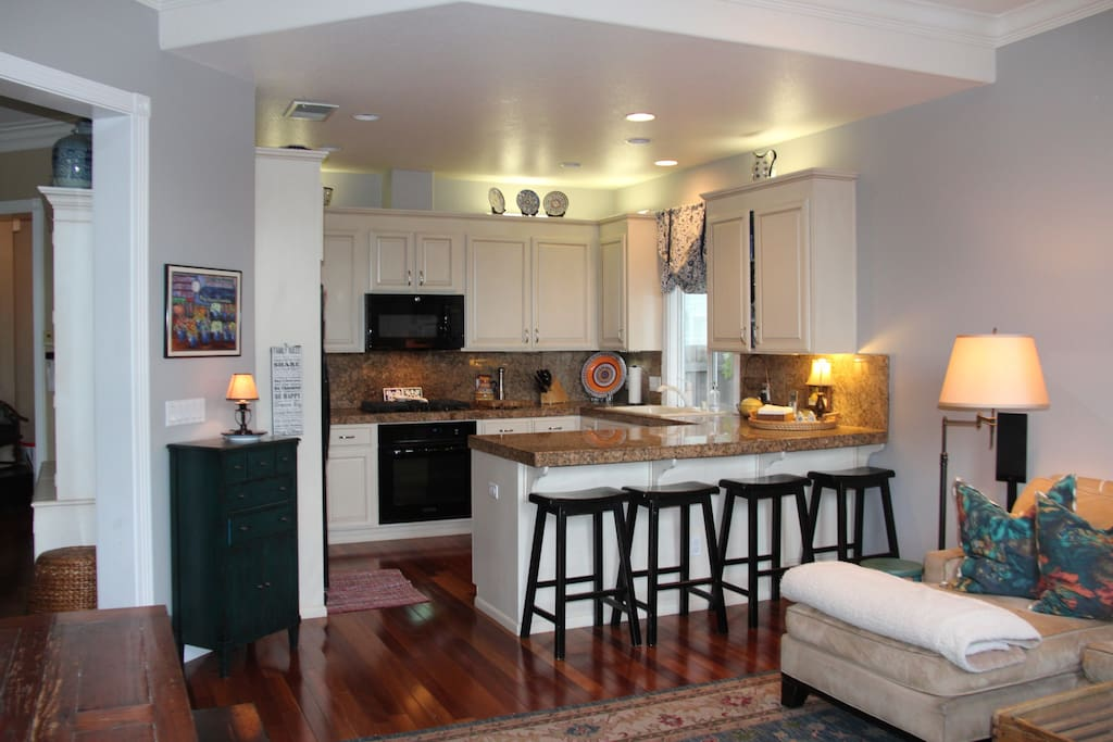 Fully equipped kitchen connected to family room.