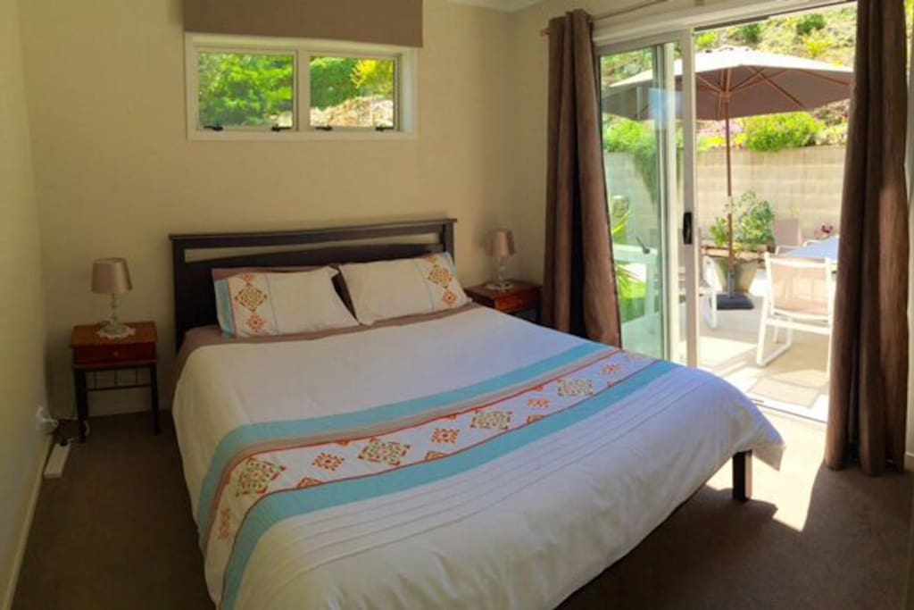 King size bed with room opening to patio