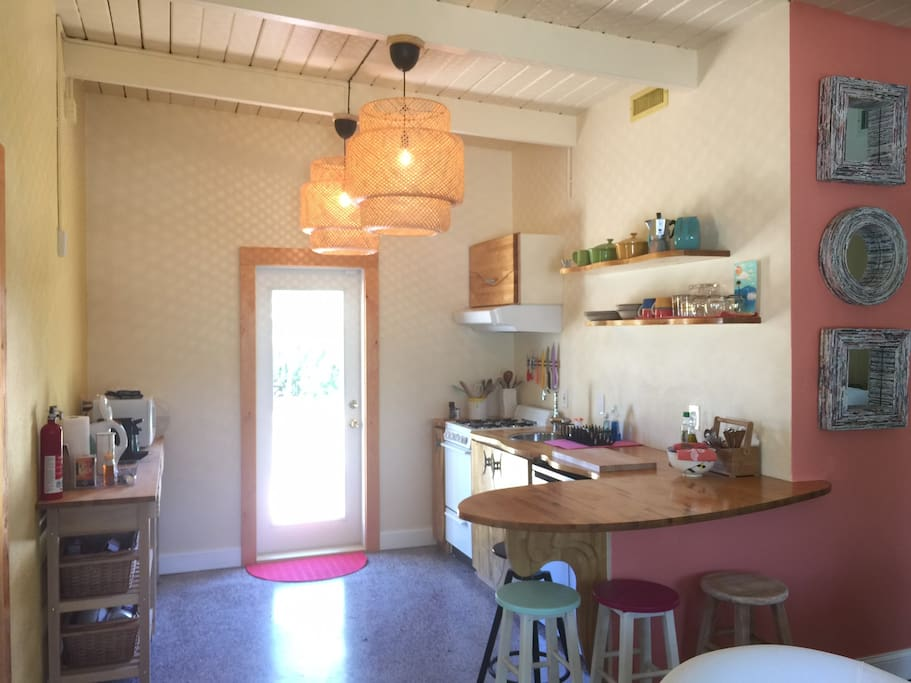 Kitchen and access to back yard.