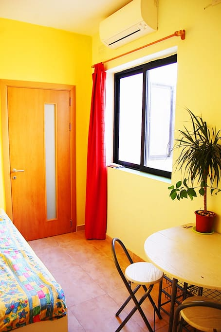 This is the view from the bathroom. Your double-bed is perfect for couples as well.