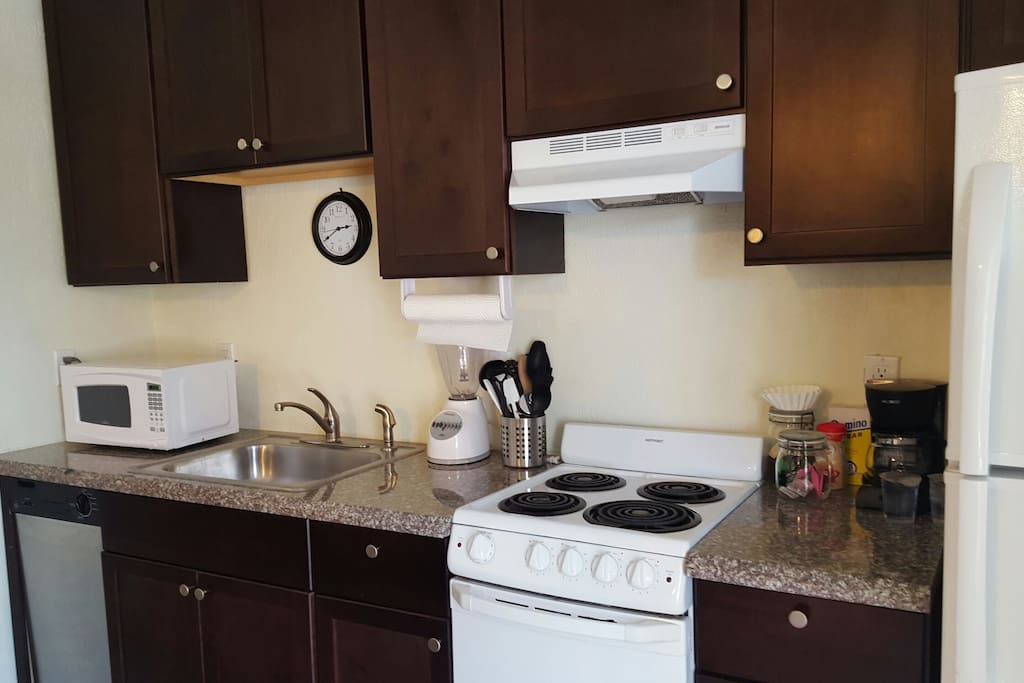 Full kitchen w/ microwave,  full size fridge, dishwasher and stove top oven