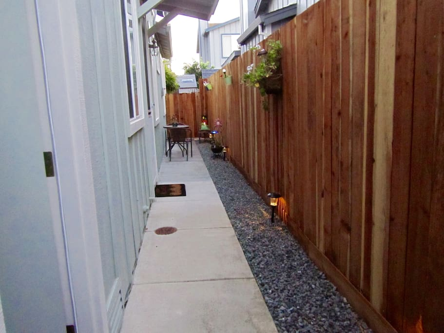 A private entrance and little side yard for your enjoyment.