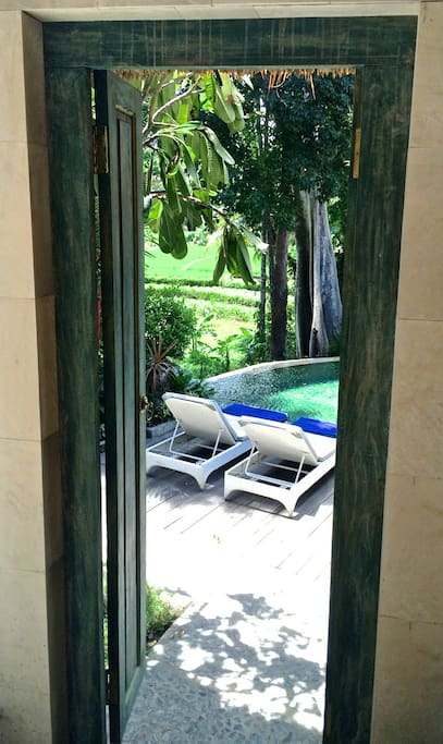 Down the garden steps past the Treehouse through the villa gate - revealing a private world, just for you!